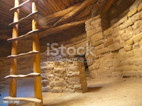 This reconstructed kiva is located in Mesa Verde National Park at the Spruce Tree House ruin location. Mesa Verde National Park is in southwest Colorado near the town of Cortez. Ray of sunlight coming through the top hole