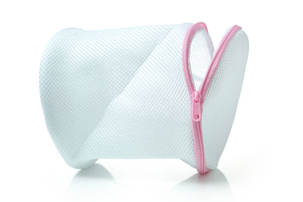 mesh laundry bag white mesh laundry bag isolated on white background netting stock pictures, royalty-free photos & images