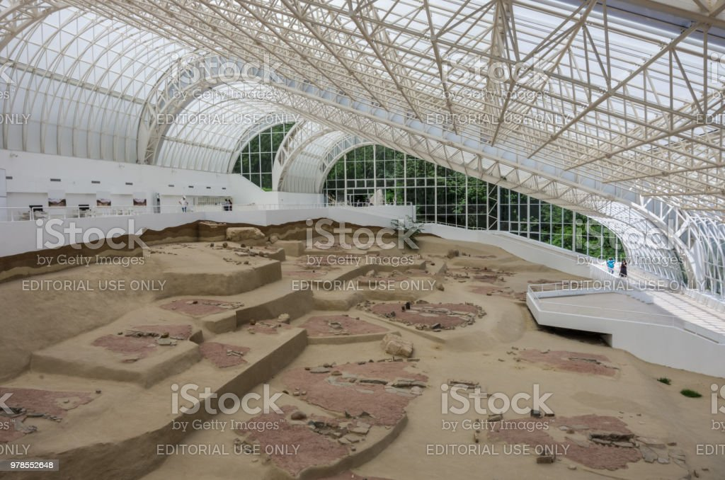 Mesolithic Archaeological site Lepen Whirl, between 9500/7200-6000 BC., visitor center under glass roof. Lepenski Vir, Serbia stock photo
