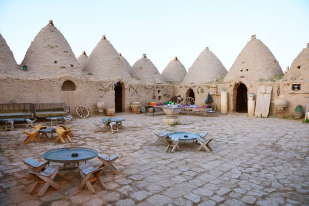 mesopotamian traditional historic mud houses in urfa mesopotamian traditional historic mud houses in urfa. It's a public guesthouse in Urfa provence wtih traditional local houses. war effort stock pictures, royalty-free photos & images