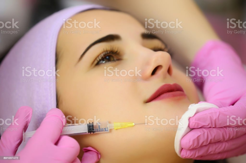 Mesotherapy injections in the face. Aesthetic cosmetology. stock photo