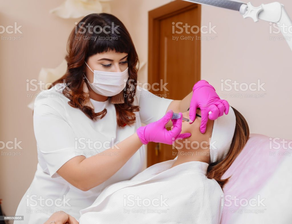 Mesotherapy injections in the face. stock photo