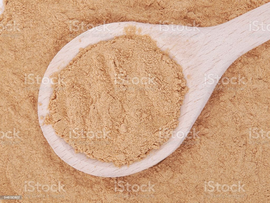 Mesquite powder in wooden spoon stock photo