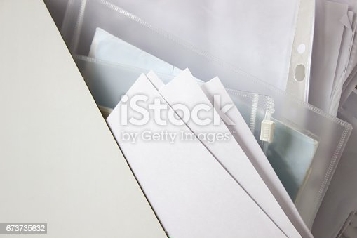 istock Mess of documents - paper in the organizer folder 673735632