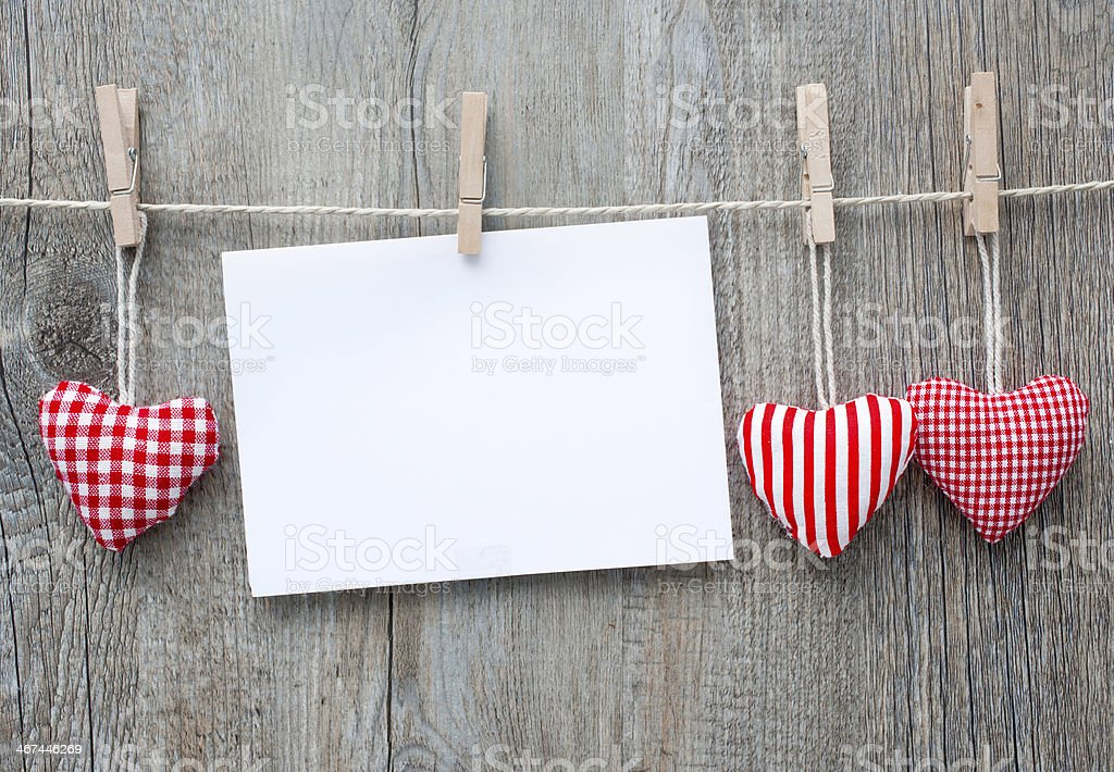 Message and red hearts on the clothesline stock photo