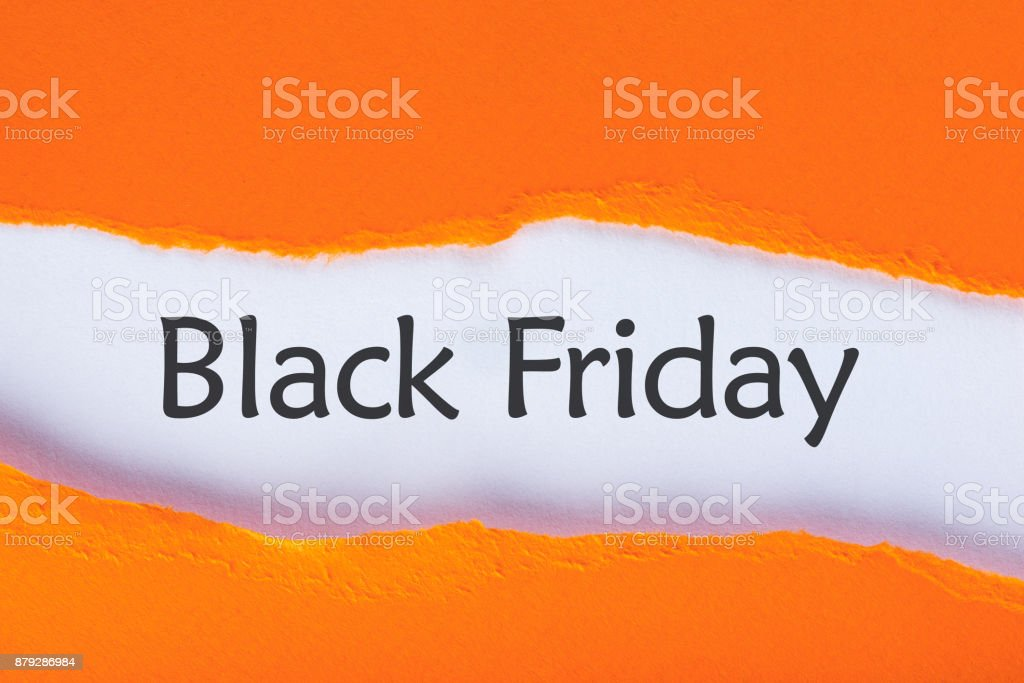 Message appearing behind ripped orange paper with Black Friday Sale text. Shopping time. Day with biggest Sale. Mockup stock photo
