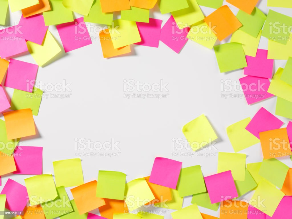 A message board covered in colorful sticky notes royalty-free stock photo