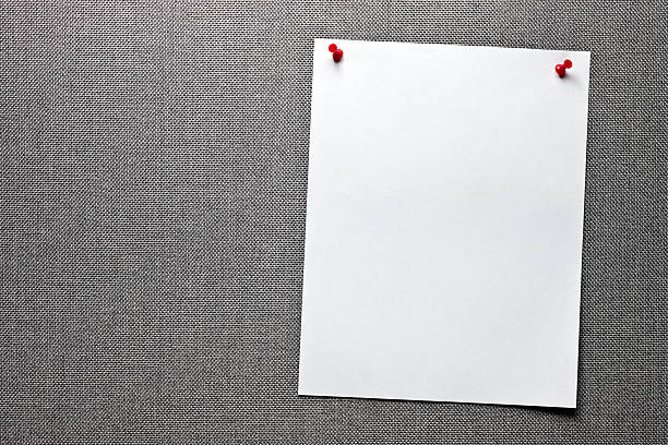Message board with two empty sheets of paper stock photo