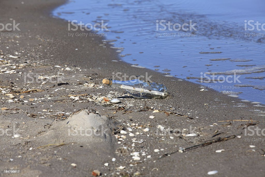 Message in a Bottle lies on the Beach royalty-free stock photo