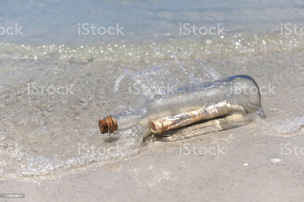 Message in a Bottle on Shore royalty-free stock photo