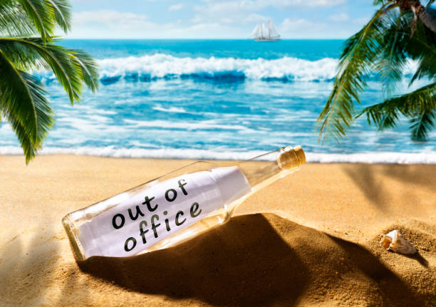 message in a bottle with the note out of office on the beach - after work stock photos and pictures