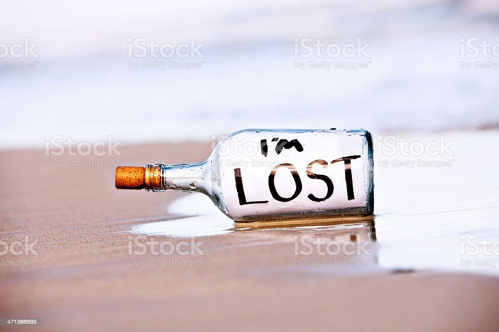 Message in bottle on empty beach says Im lost royalty-free stock photo