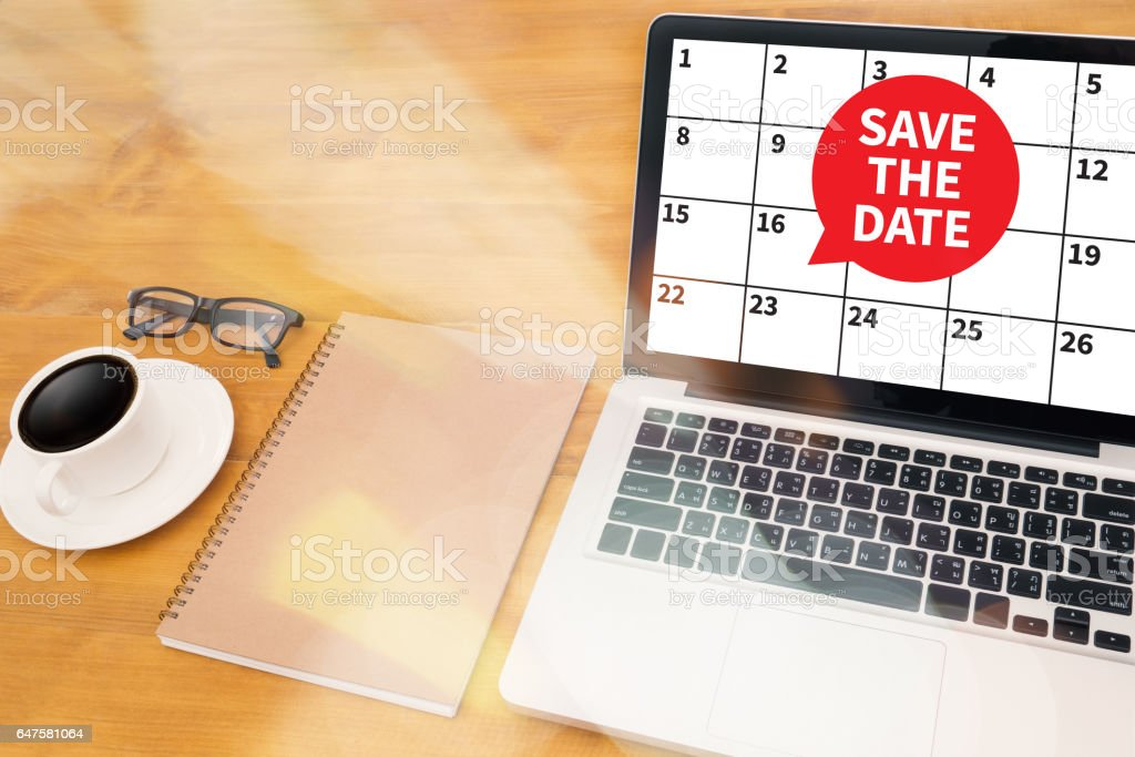 SAVE THE DATE message on hand holding to touch stock photo