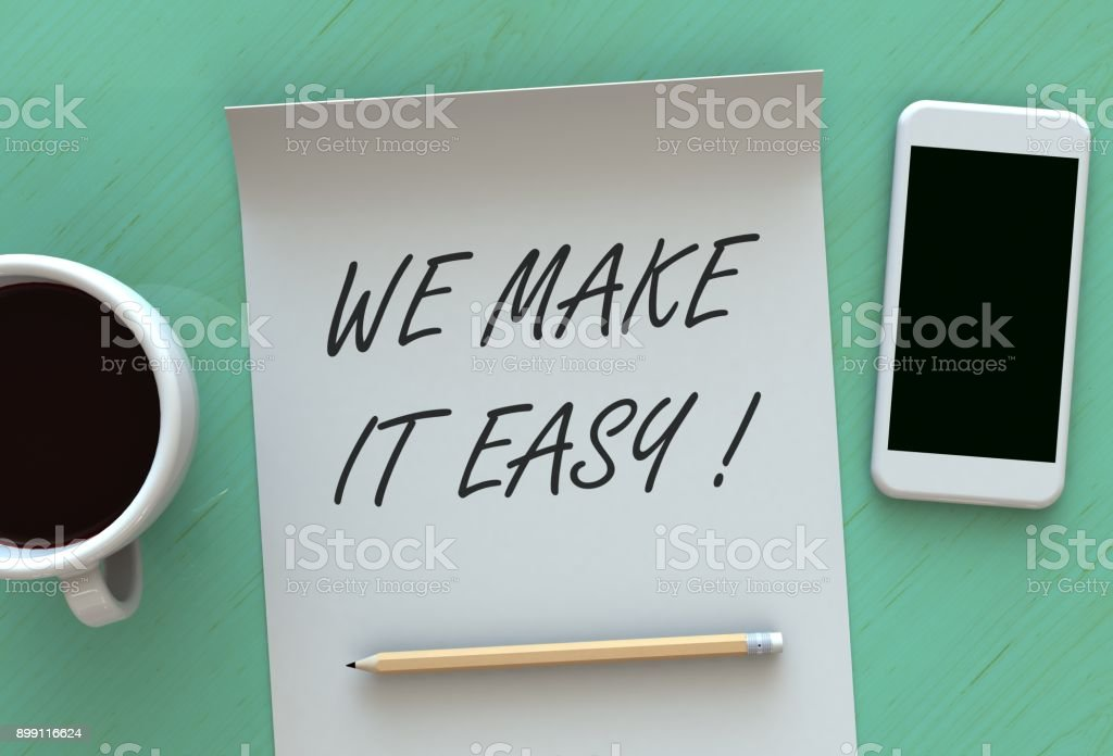 WE MAKE IT EASY, message on paper, smart phone and coffee on table stock photo