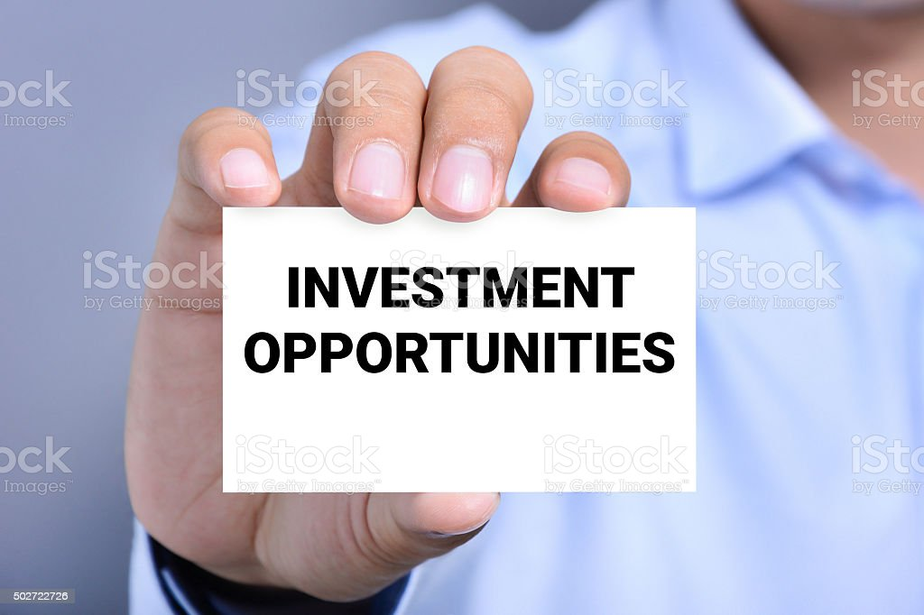 INVESTMENT OPPORTUNITIES message on the card stock photo
