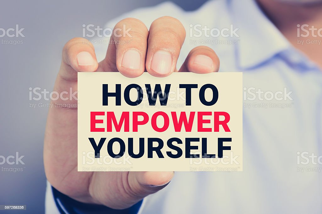 HOW TO EMPOWER YOURSELF, message on the card royalty-free stock photo
