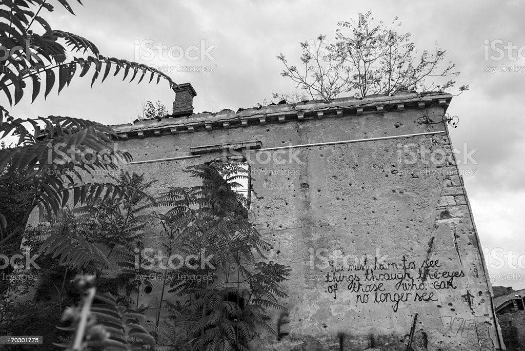 Message on war-damaged building in Mostar, Bosnia stock photo
