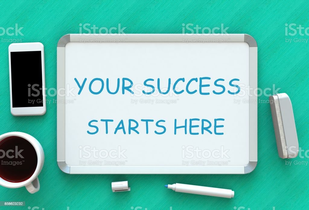 YOUR SUCCESS STARTS HERE, message on whiteboard, smart phone and coffee on table, 3D rendering stock photo