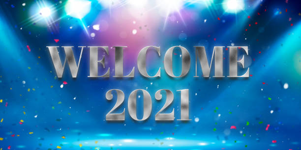 message WELCOME 2021 in front of particle background stock photo