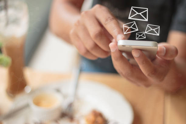 Messages icons on virtual screen. Communication concept.hand using phone with email icon, Email concept Messages icons on virtual screen. Communication concept.hand using phone with email icon, Email concept newsletter stock pictures, royalty-free photos & images