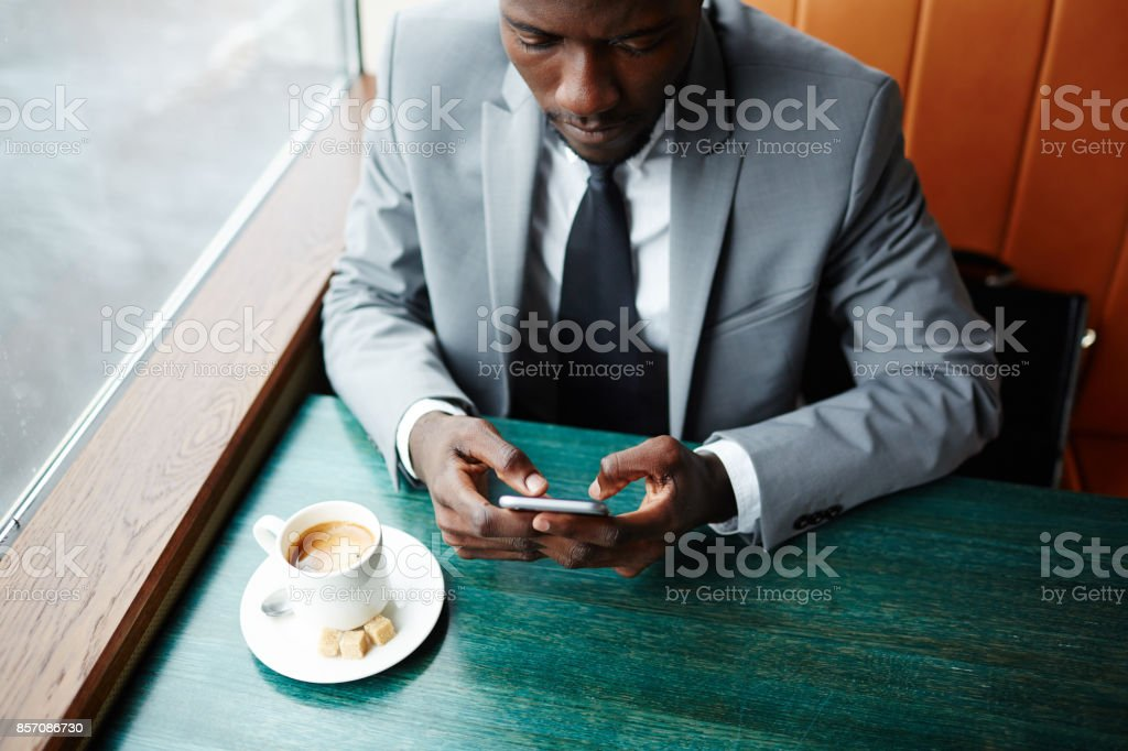 Messaging in cafe stock photo