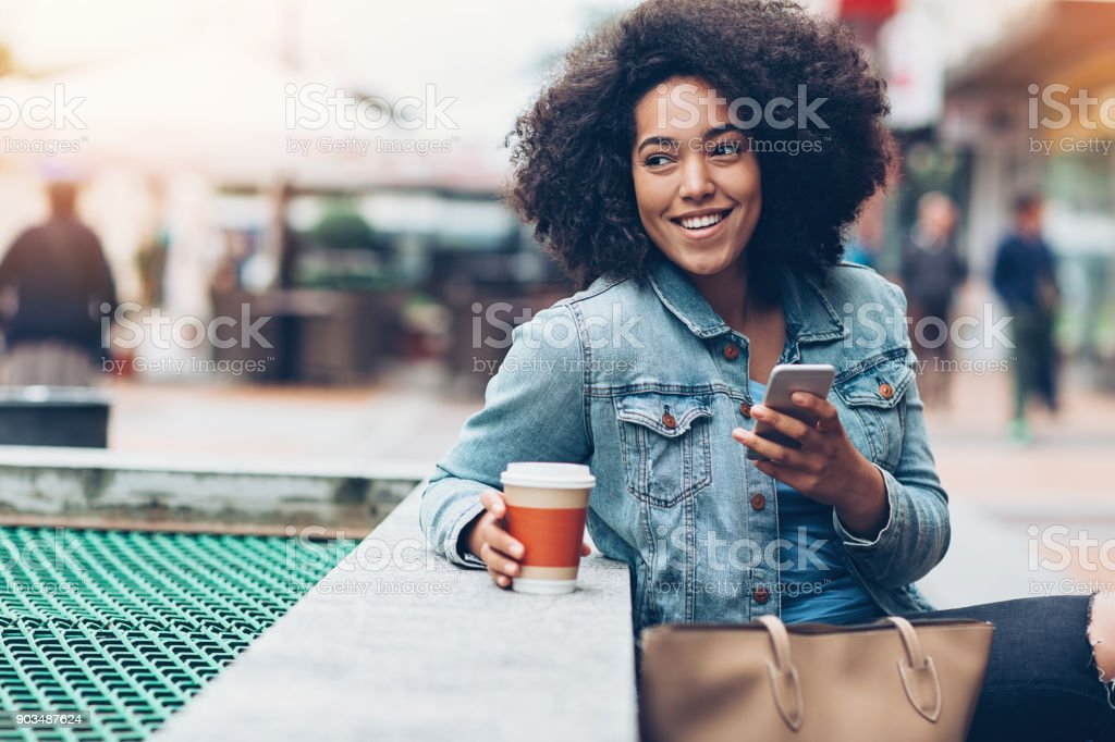 Messaging outdoors in the city stock photo