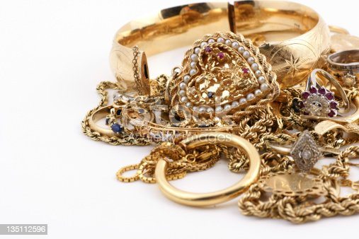 Close-up of 14k gold jewelry. Plenty of copy space.