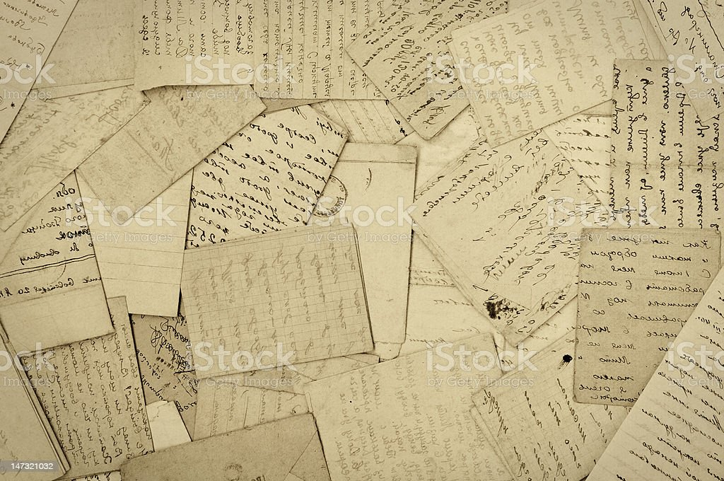 A messed up stack of old stained linen paper stock photo