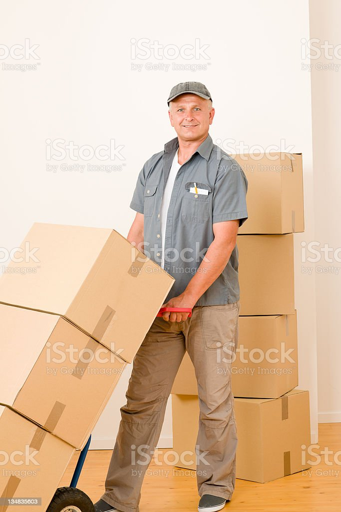 Messenger mature male courier delivering parcels royalty-free stock photo