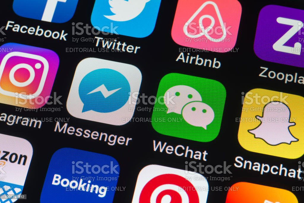 Messenger, WeChat, Snapchat and other phone Apps on iPhone screen stock photo