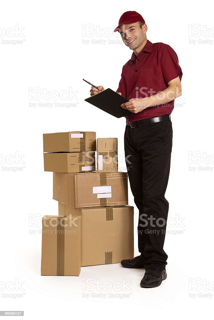 Messenger with clipboard and stack of brown boxes - Royalty-free Adult Stock Photo