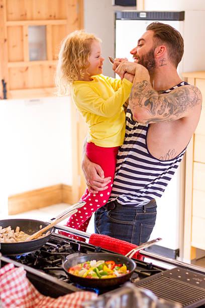 unternehmungen in der küche - lausbub tattoo stock-fotos und bilder