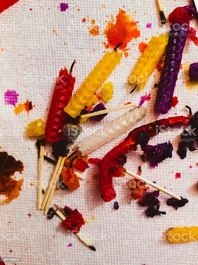 Messthetics. Burnt candles and matches on the paper towel. stock photo