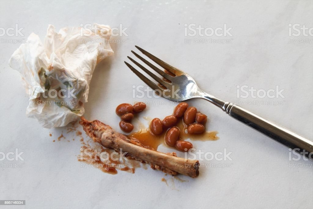 Messthetics - messy remnants of barbecue ribs meal stock photo