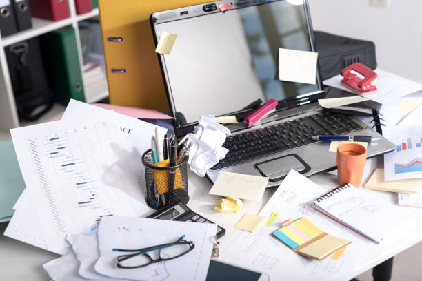 Messy and cluttered desk stock photo