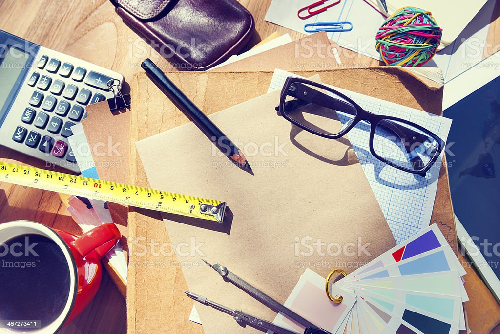 Messy Architect's Table with Work Tools stock photo