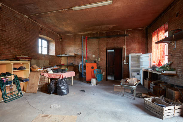 Messy basement with red bricks walls in old country house Messy basement with red bricks walls in old country house cellar stock pictures, royalty-free photos & images