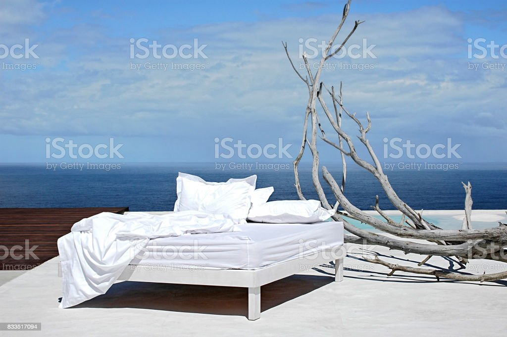 messy bed with view stock photo