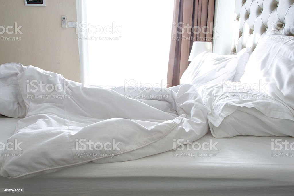 Messy bedding sheets and pillow in hotel room messy bedding sheets and pillow Bed - Furniture Stock Photo
