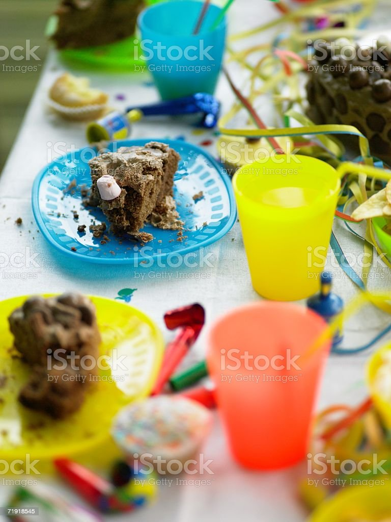 Messy birthday party table stock photo