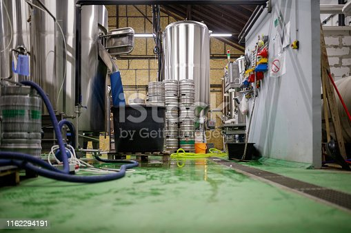 Messy brewery interior, no people
