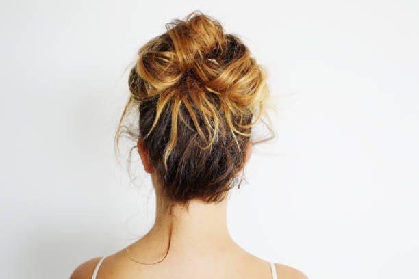 messy bun - messy hair stock photos and pictures