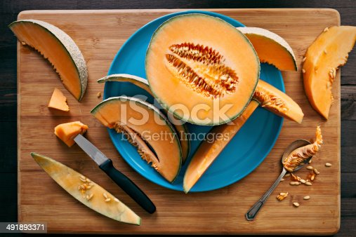 An overhead close up shot of the works of a messy cantaloupe eater.