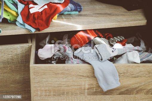 1164403364 istock photo Messy child drawer with socks 1220797290