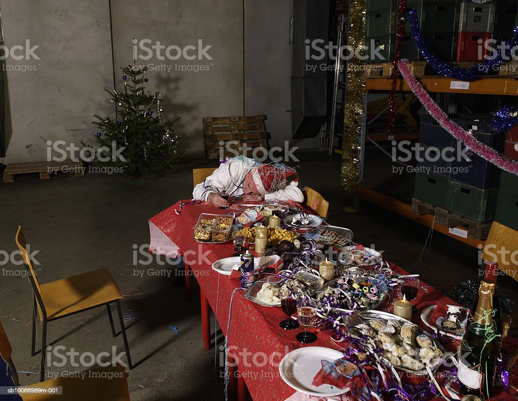 Messy christmas table in warehouse, elevated view royalty-free stock photo