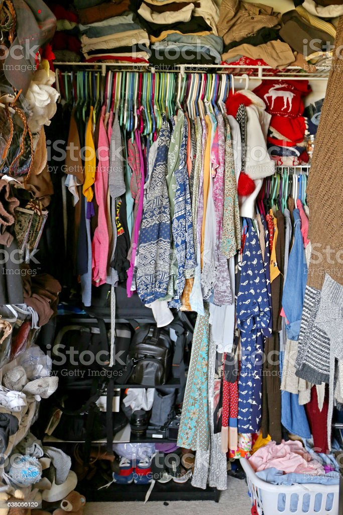 Messy Closet Filled with Woman's CLothes stock photo