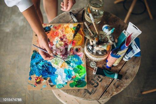 istock Messy creative art studio 1015474788