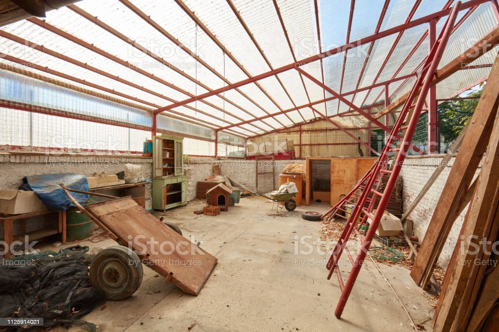Messy deposit with plastic roof in old country house in Italy