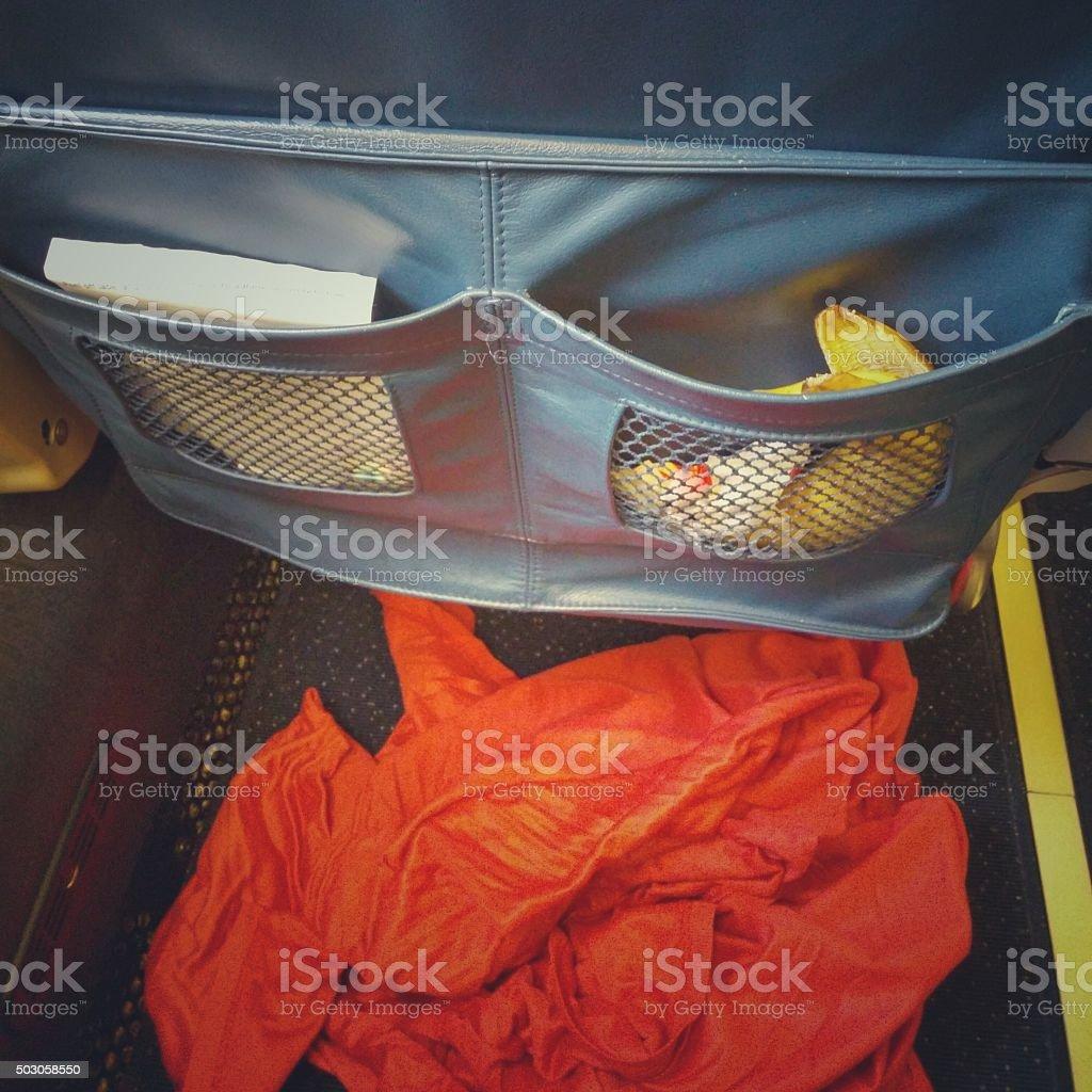 Messy Dirty Airplane Passenger Seat Pocket, Trash, Banana Peel, Blanket - Royalty-free Airplane Stock Photo