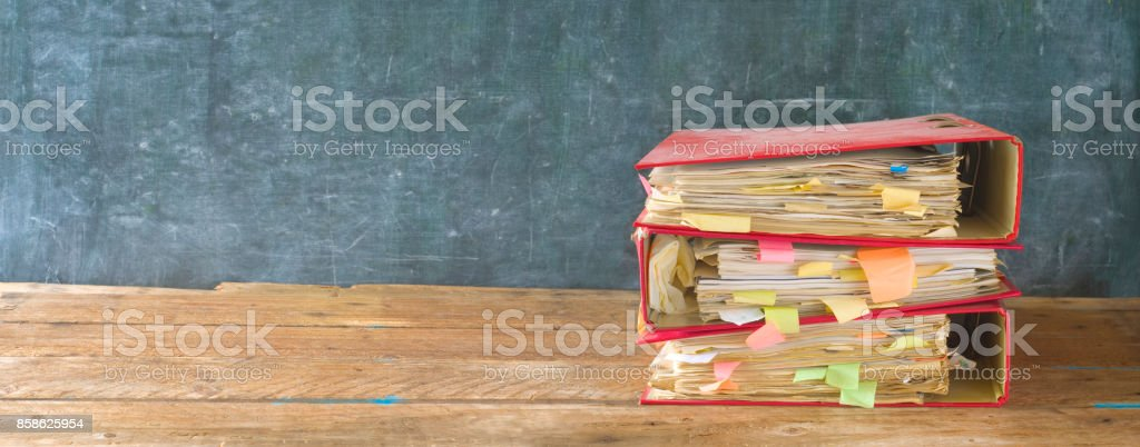 messy file folders, on grungy background stock photo